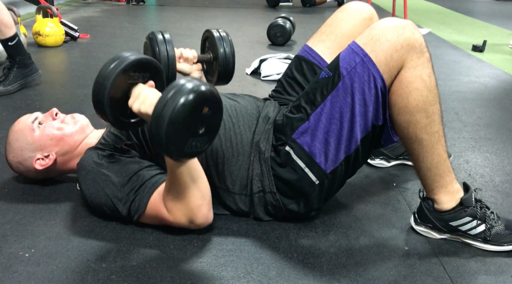 Floor Dumbbell Press for Baseball and Softball Players